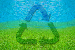 Recycle symbol on lake of dreams. For background royalty free stock photo