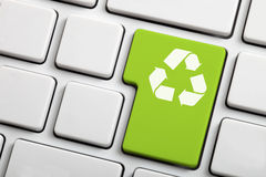Recycle symbol on a laptop keyboard royalty free stock photos