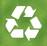 Recycle symbol made on grass outlines. 3d image render Stock Images