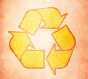 Recycle symbol on old textures Stock Images