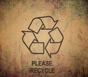 Recycle symbol on old textures Royalty Free Stock Image