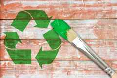 Recycle symbol painted on the wooden wall. Paintbrush and recycle symbol painted on the wooden wall Royalty Free Stock Photography