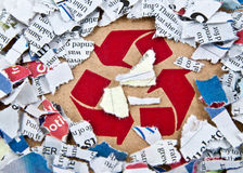 Recycle symbol with pieces of paper Stock Photography