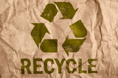 Recycle symbol. Rough paper with recycle symbol Stock Photos