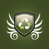 Recycle symbol shield emblem. On green background Royalty Free Stock Images