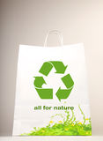 Recycle symbol on the shopping bag. Conceptual image of nature conservation Stock Photography
