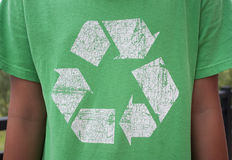 Recycle Symbol T-Shirt. The recycle symbol on a green T-Shirt Stock Image
