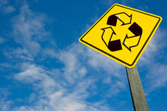 Recycle symbol on traffic sign. Royalty Free Stock Photography