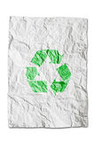 Recycle symbol on wrinkled paper isolated. On white background royalty free stock photography