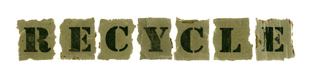 Recycle text on recycled paper Royalty Free Stock Photo
