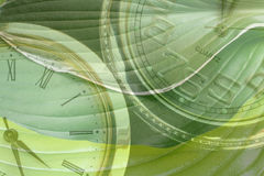 Recycle. Time after time. An artistic environmental montage of clocks & green leaf pattern Stock Photos