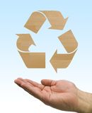 Recycle wood hand. One hand care the recycle logo, wood element Stock Image