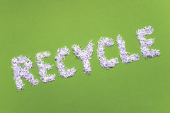 Recycle word on green Stock Photography