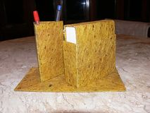 Recycled. Notebook and pen holder made with recycled paper - yellow Royalty Free Stock Images