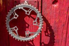 Recycled bicycle crank as door handle Stock Image