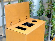 Recycled bin made from recycle paper. Different hole of trash bo. X for waste management. Perspective disposal view for saving environmental concept Royalty Free Stock Photo