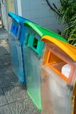 Recycled bin at parking area. Different color trash cans in row. For waste management. Perspective disposal view for saving environmental concept Stock Photography