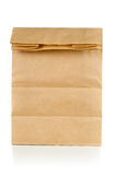 Recycled brown paper doggy bag over white background Royalty Free Stock Photo
