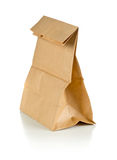 Recycled brown paper doggy bag over white background Stock Image