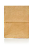 Recycled brown paper doggy bag over white background Royalty Free Stock Photos