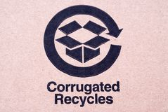 Recycled Cardboard. Corrugated recycles sign on a cardboard box stock images