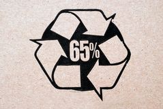 Recycled Cardboard. 65% recycled cardboard sign on a crdboard box stock image