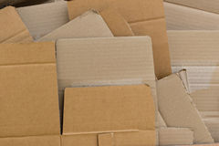 Recycled cardboard flattened and arranged pile Stock Images
