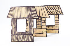 Recycled cardboard made houses. Straw, sticks and briks houses made with cardboard Stock Images