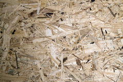 Recycled compressed wood chipboard. Pressed Wooden Panel & x28;OSB& x29;. Stock Images