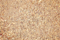 Recycled compressed wood chippings board. Close up recycled compressed wood chippings board stock image