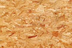 Recycled compressed wood chippings board. Texture Royalty Free Stock Photos