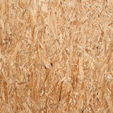 Recycled compressed wood chippings wall. Recycled compressed wood chippings board Stock Photos