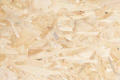 Recycled comprimió textura o el fondo del tablero de la madera contrachapada Foto de archivo