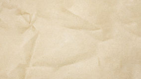 Recycled crumpled brown paper texture background. Royalty Free Stock Images