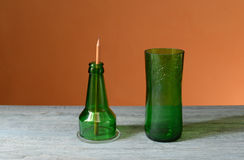 Recycled glass bottle as a pencil holder Royalty Free Stock Photo