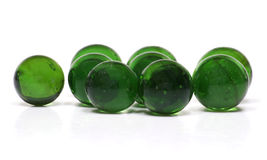 Recycled Glass Marbles. A handful of marbles, made from recycled glass bottles, isolated on a white background Stock Image