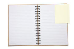 Recycled notebook cover open with yellow reminder. Recycled paper notebook cover open with yellow reminder in isolated stock photo
