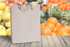 Recycled paper bag. Some natural fruits and vegetables. Empty copy space Stock Image