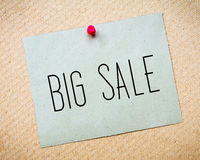 Recycled paper note pinned on cork board.Big Sale Message Stock Photo
