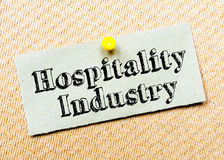 Recycled paper note pinned on cork board. Hospitality Industry Message. Concept Image stock images