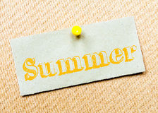 Recycled paper note pinned on cork board. Summer Message Royalty Free Stock Images