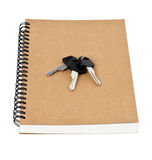 Recycled paper notebook front cover and car keys  isolated Royalty Free Stock Photos