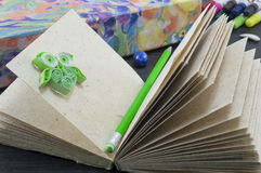 Recycled paper notebook with a green pen and green paper owl Stock Photos
