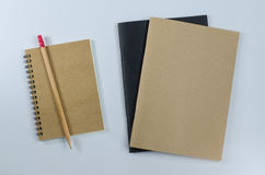 Recycled paper notebook pencils white background Stock Photos