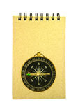 Recycled paper notebook and pocket compass isolated Stock Image