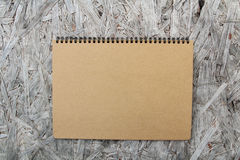 Recycled paper notebook on wood Stock Photography