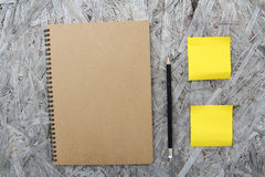 Recycled paper notebook on wood Stock Photo