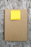 Recycled paper notebook on wood Royalty Free Stock Photography