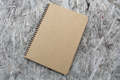 Recycled paper notebook on wood Stock Images