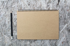 Recycled paper notebook on wood Stock Image